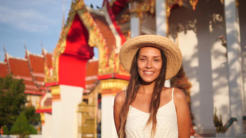 Portrait of Beautiful Smiling Young Mixed Race Tourist Woman in Straw Hat with ビデオ