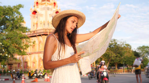 Young Mixed Race Tourist Girl with City Map Looking Around and Exploring Footage