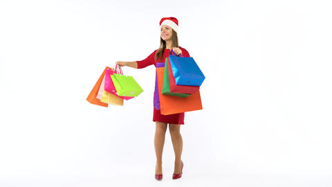 Christmas female shopper holding multicolored shopping bags and crazy dancing on Footage