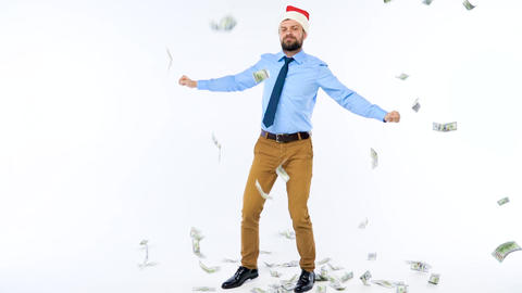 Dollars falling on formally dressed man in the Santa Claus hat Footage