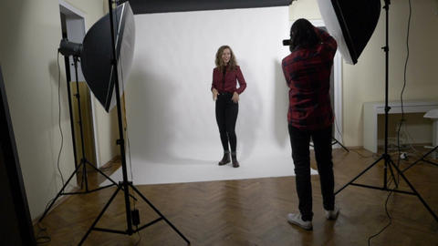 Young attractive fashion model at work striking a pose while being photographed Footage