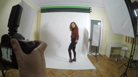 Point of view of a young photographer taking professional pictures with a Footage