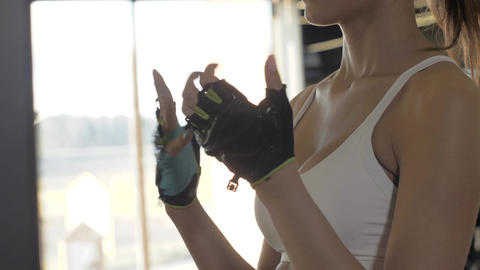 Fitness woman making warm up exercises hands for endurance training in gym club Footage