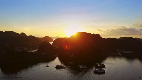 Bright Sun Disk Appears at Tropical Sunrise above Quiet Ocean Footage
