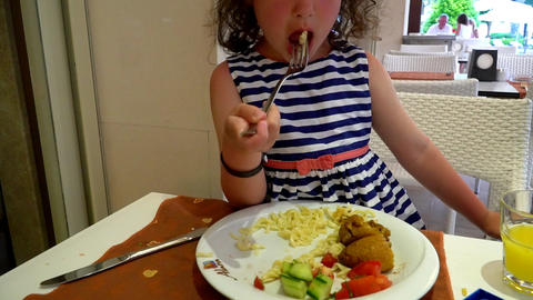 little girl eating at table Footage