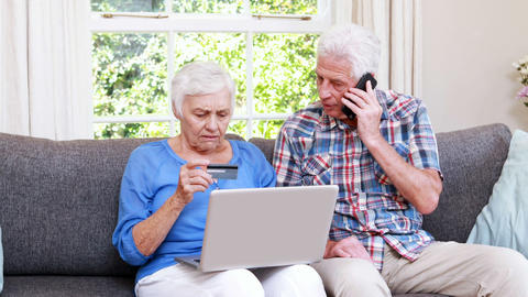 Senior couple holding credit card Footage