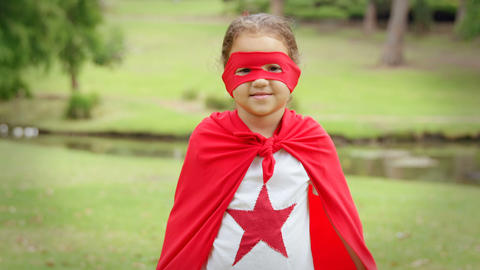 Masked girl pretending to be superhero Live Action