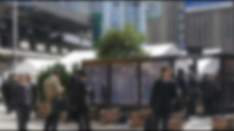 Blurred anonymous crowd in a business district during lunch break Footage