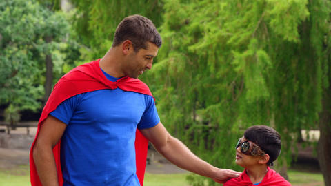 Father and son pretending to be superhero Live Action