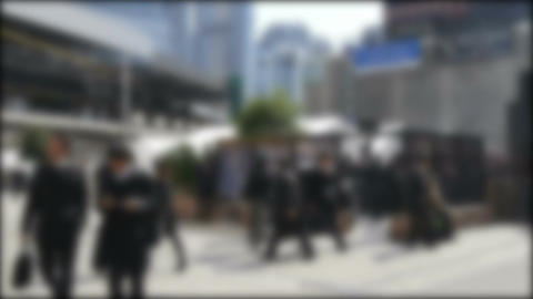 Slow motion view of anonymous business men gathering around the smoking area in  Footage
