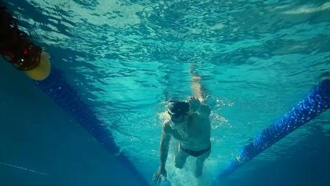 Underwater view of man swimming Footage