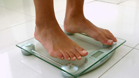 Feet of woman on weighting scale Footage