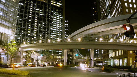 Motion timelapse of busy street lights in central Shiodome district Footage