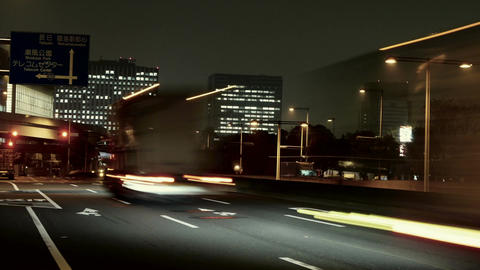 Motion nightlapse (zoom out) of traffic illumination in the industrial area of Footage