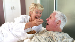Senior woman feeding her husband Footage