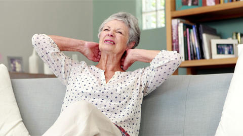 Senior woman suffering from neck pain Footage