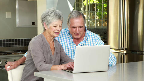Senior couple using laptop Footage