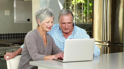 Senior couple using laptop Footage