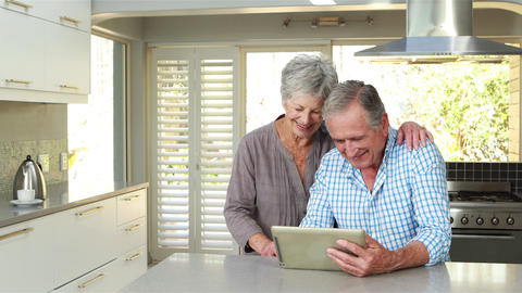 Senior couple using tablet pc Footage