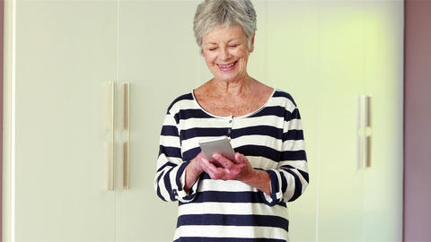 Senior woman using her smart phone Footage