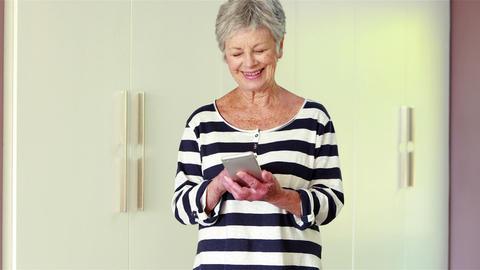 Senior woman using her smart phone Footage