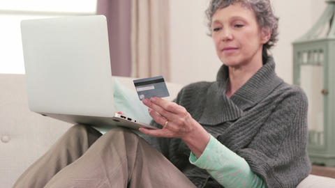 Woman using her card to buy online Footage