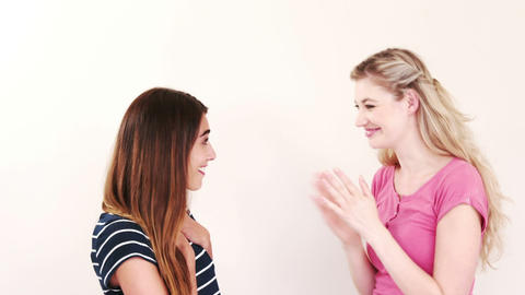 Blonde telling secret to brunette friend Live Action