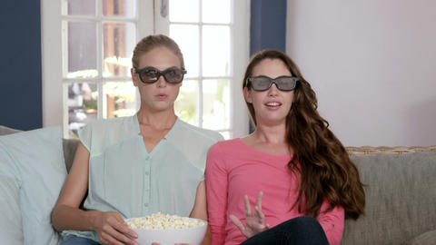 Scared women watching a 3D movie Footage