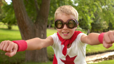 Little boy pretending to be superhero Footage