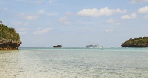 Pleasure cruise boat departing the coast of Kabira Bay in beautiful Ishigaki Isl Footage