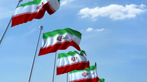 Multiple waving flags of Iran against the blue sky Footage
