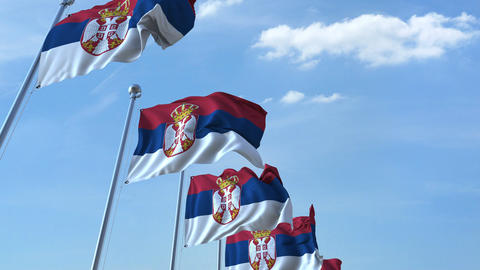Multiple waving flags of Serbia against the blue sky Footage