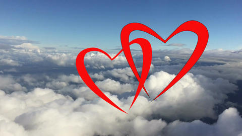 Couple of loving red hearts flying at cloud blue sky together. Red hearts as Footage