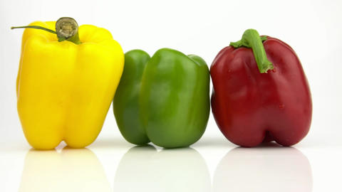 Three peppers on a white background Footage