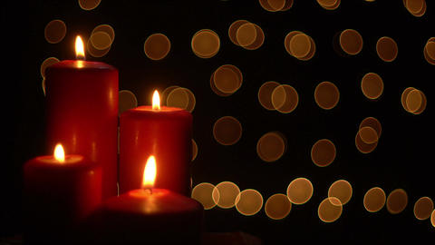 Red candles lights on bokeh background Footage