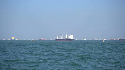 Cargo ships floats on waves in the blue sea ビデオ