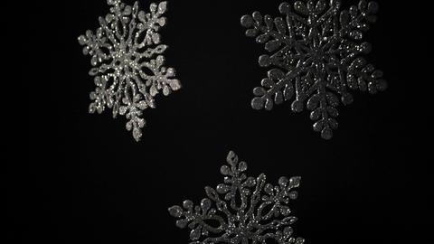 decorative shining snowflakes rotating black wall Footage