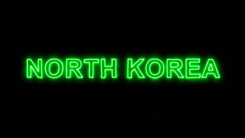 Neon flickering green country name NORTH KOREA in the haze. Alpha channel Animation