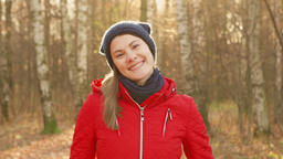 Happy Smiling Woman Enjoying Nature. Standing in autumn park. Young pretty Footage