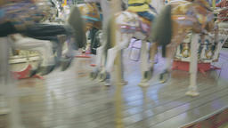 Pony rides on a merry-go-round carousel Footage