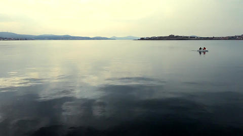 Evening On The Calm Lake With Distant Boat Footage