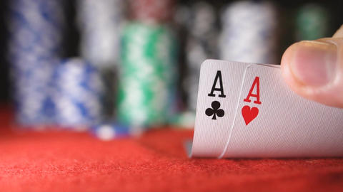 Poker player showing good card combination, pair of aces in slow motion Footage