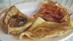 Pancakes on a plate with jam Footage