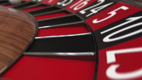 Casino roulette wheel ball hits 14 fourteen red Footage