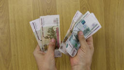 Man counting russian paper money, rubles Footage