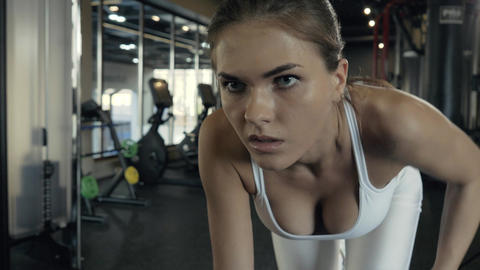 Beautiful fitness woman training with weights dumbbells on modern sports club Footage