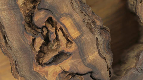 Close-up of the rotation of a very unusual texture of walnut wood. Emptiness Footage