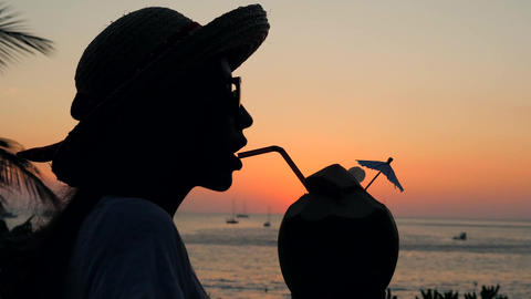 Young Tourist Woman Drinking Fresh Thai Coconut Water Coctail on the Beach Live Action