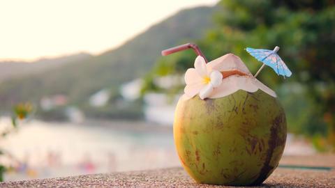 Fresh Young Thai Coconut Water Coctail at Tropical Beach Bar. Phuket, Thailand Footage