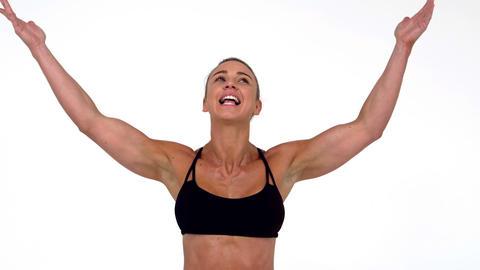 Female athlete raising arms Live Action